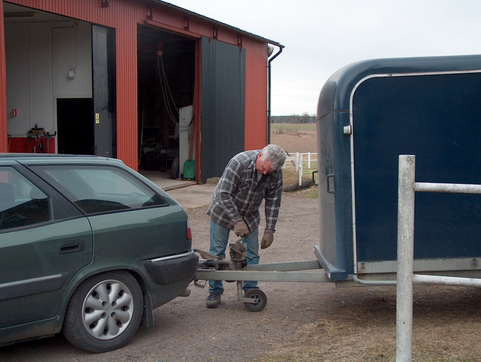 My husband prepares the trailer to move the boys