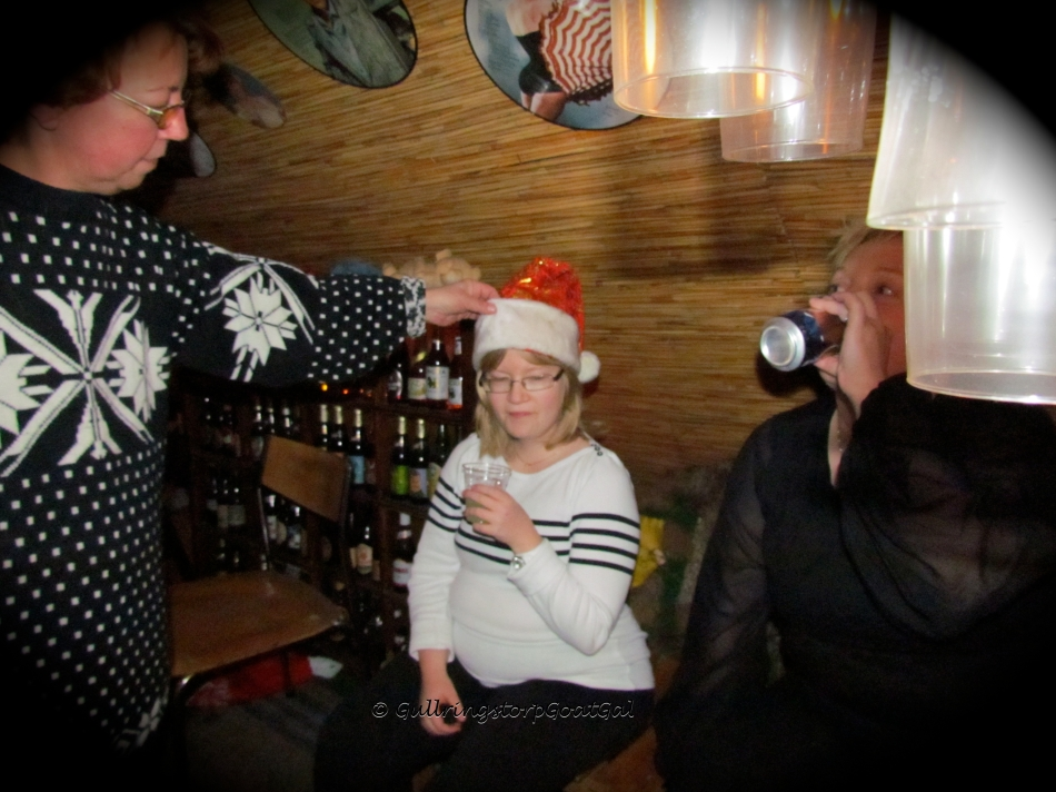 Our hostess Irene, gently adjusts the hat for our Tomte Sabina