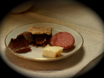 A nice plate of cheese, salami and reindeer