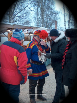 A Sami man selling handcrafted knives. The handles are made from reindeer antlers