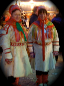 Two Sami ladies in beautiful reindeer dresses