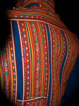 What fantastic, beautiful  and colorful stitching on these traditional jackets