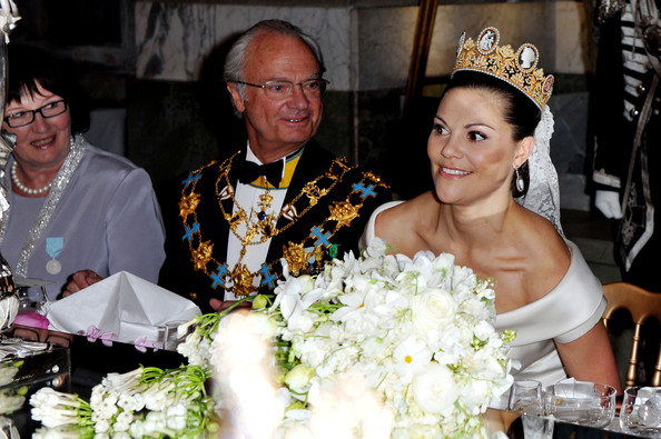 HRH Crown Princess  Victoria at her wedding sitting next to her  father King Carl XVI Gustof