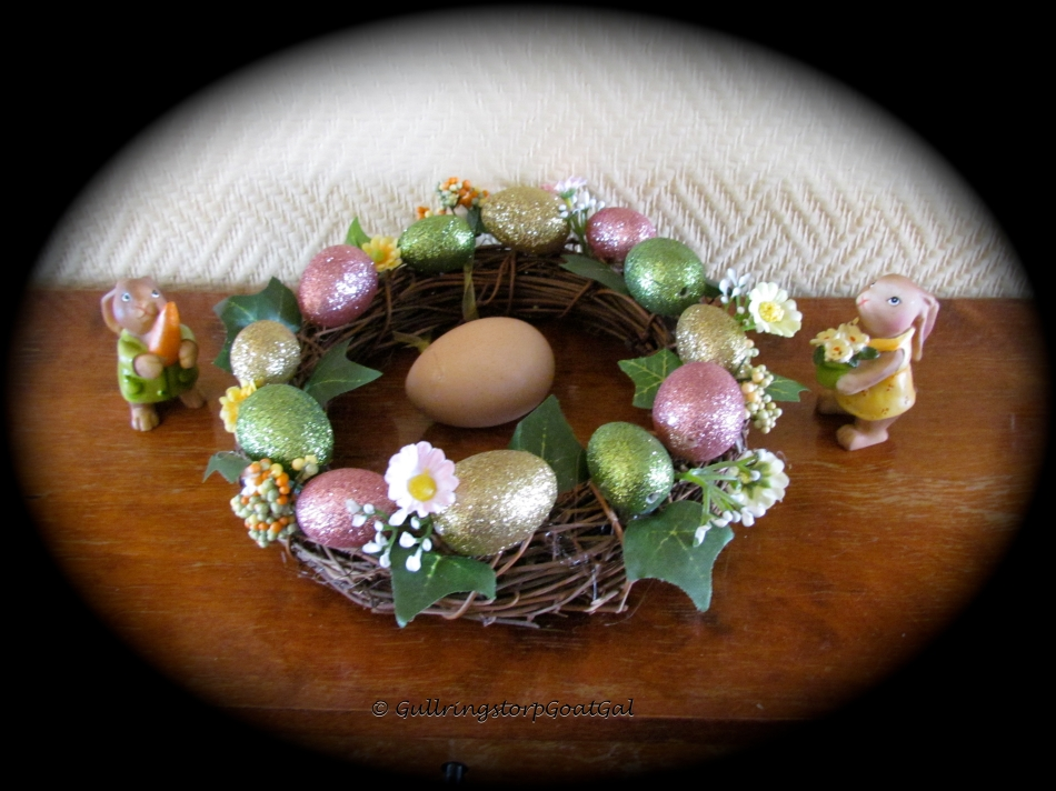 A traditional Easter Wreath with colorful eggs makes a nice piece on our entrance hall table, with two cute bunnies, of course. We also added an egg from our chicken house