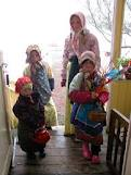 These little Eater witches are at the door of a neighbor, all dressed up and carrying their birch branches with feathers