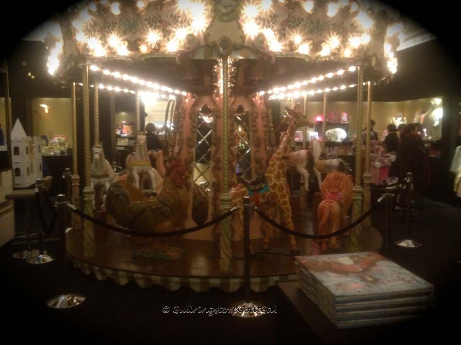 I have never seen a merry-go-round in a toy department of any store, but in Paris at Le Bon Marche