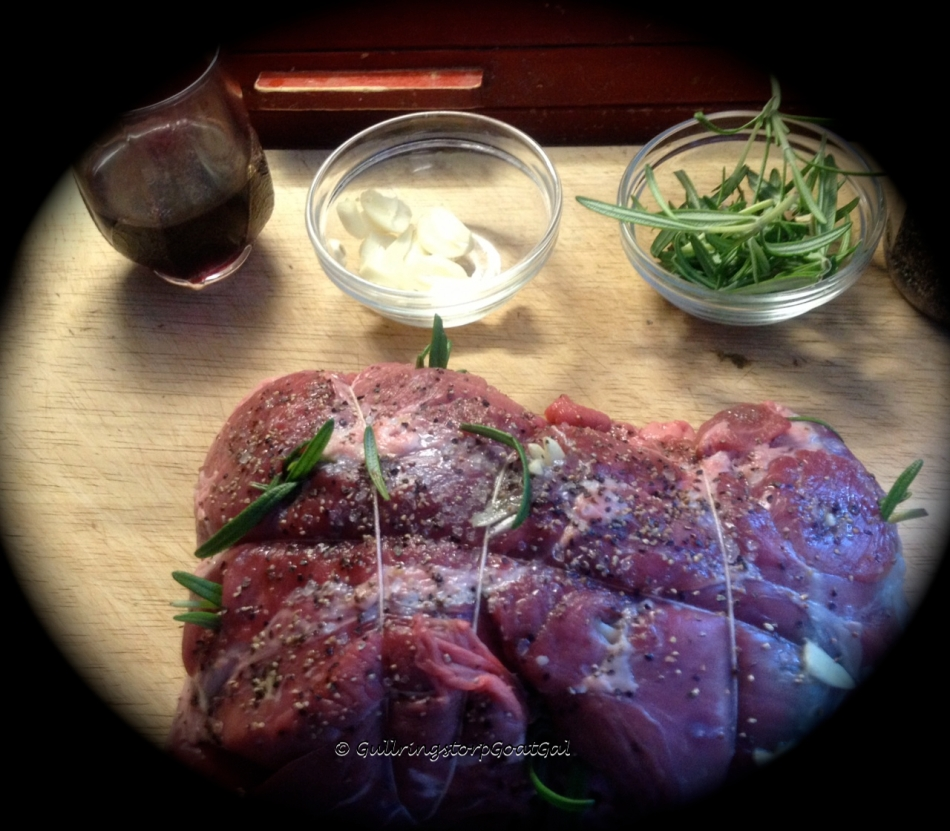 Once the twine was done, the lamb was pierced and slivers of garlic were inserted for added flavor and small twigs of fresh Rosemary also inserted for flavor