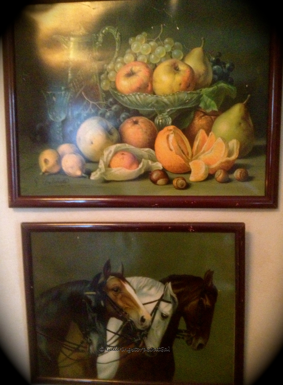 Two very old beautiful paintings were hung in the buffet room
